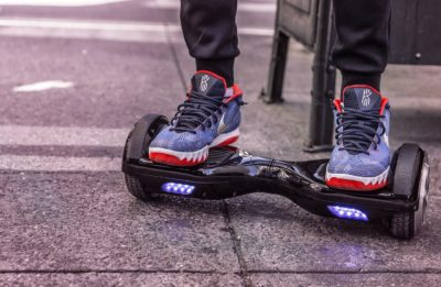 Shoes of a boy riding a hoverboard for kids