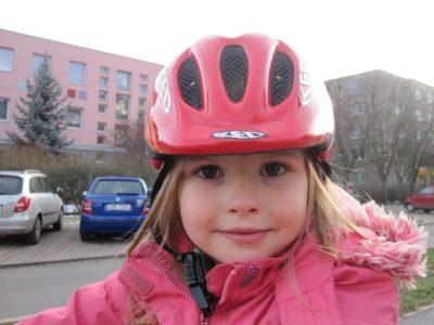 girl wearing pink helmet